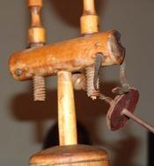 Wooden_screws_on_minors_head